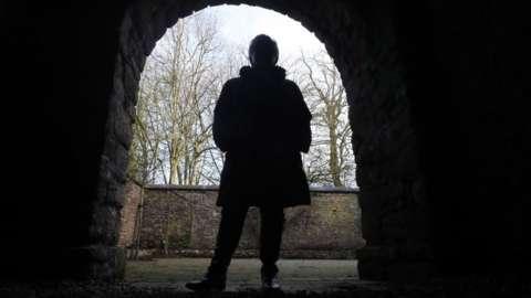 Adele seen in silhouette