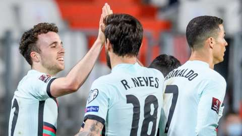 Diogo Jota (left) celebrates scoring