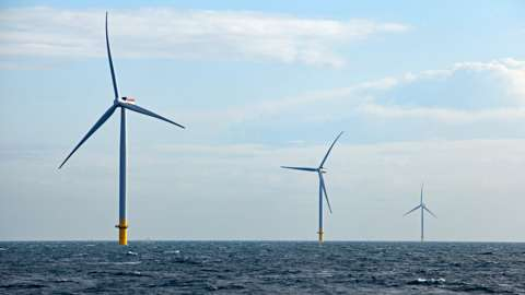 Three wind turbines off the Yorkshire coast in the North Sea