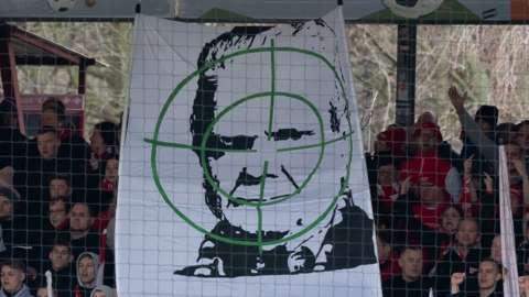 Banner of Hoffenheim president Dietmar Hopp in crosshairs