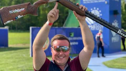 Matthew Coward-Holley celebrates winning trap gold at the 2021 European Shooting Championships