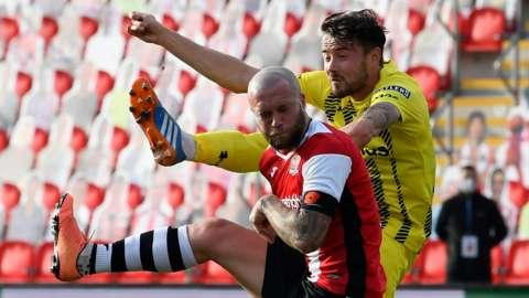 Fylde's Jordan Lussey challenges Nicky Law of Exeter