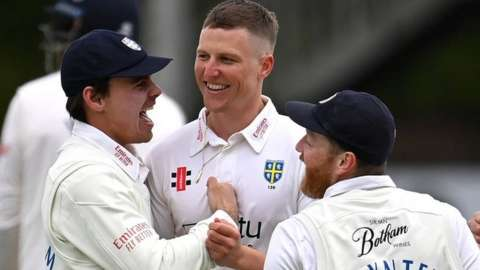 Durham celebrate a wicket for Brydon Carse