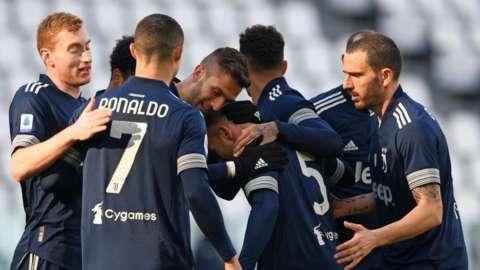 Juventus's Arthur Melo scores