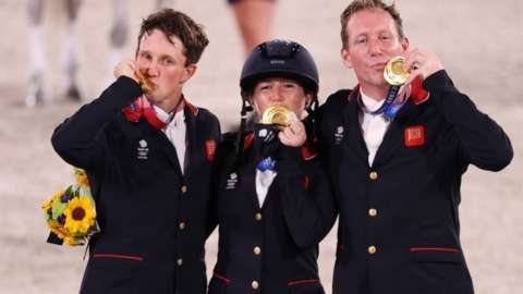 Gold medallists Oliver Townend of Britain, Laura Collett of Britain and Tom McEwen of Britain celebrate. REUTERS/Molly Darlington