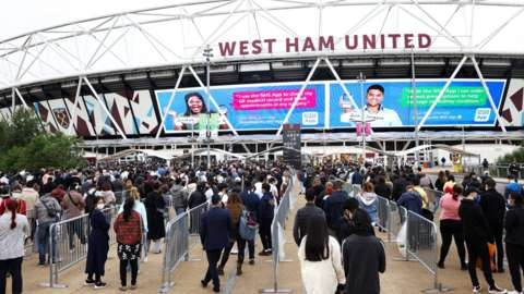 Queues at a temporary vaccination centre at West Ham's London Stadium