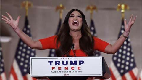 Kimberly Guilfoyle holds outstretched arms as she speaks in Washington DC