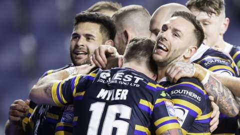 Leeds Rhinos players celebrate a try