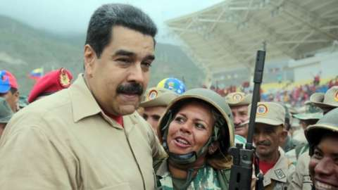 Venezuelan President Nicolas Maduro embraces members of the Bolivarian militia during a military training in Caracas on May 21, 201