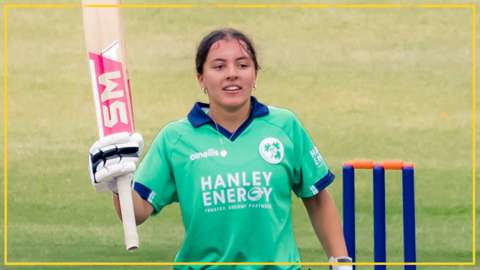 Amy Hunter celebrates after hitting her century for Ireland in Harare