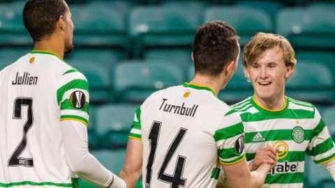 Celtic's Christopher Jullien, David Turnbull and Euan Henderson celebrate