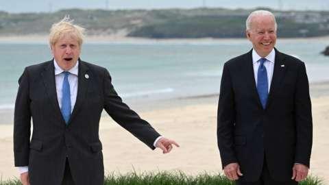 Boris Johnson and Joe Biden on a beach in Cornwall during the G7 earlier this year