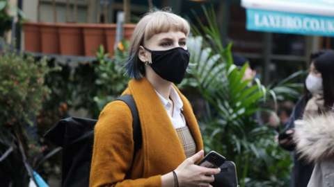 Woman in face mask at outside market
