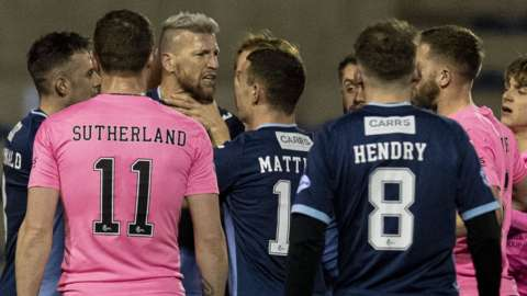 Raith Rovers' Iain Davidson (third left) is confronted