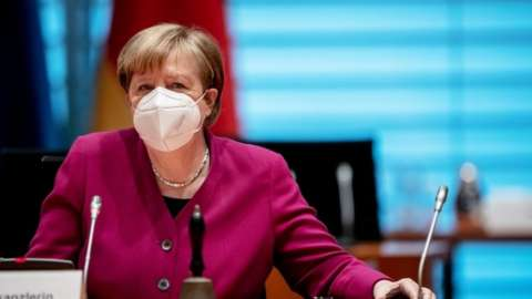 German Chancellor Angela Merkel wears a protective face mask before the weekly cabinet meeting of the German government