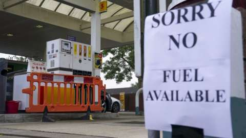 A petrol station with a sign saying no fuel available
