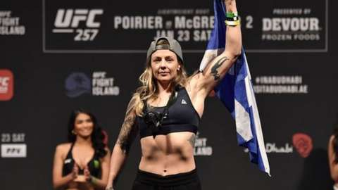 Joanne Calderwood holds Scottish flag at weigh in for her last fight at UFC 257 in Abu Dhabi