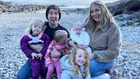 Darren, partner Katie, and their daughters.