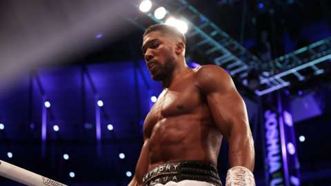 Anthony Joshua looks on after a loss