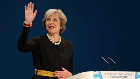 Theresa May takes to the stage to deliver a speech to about Brexit on the first day of the Conservative Party Conference 2016