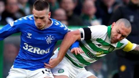 Rangers' Ryan Kent and Celtic's Scott Brown