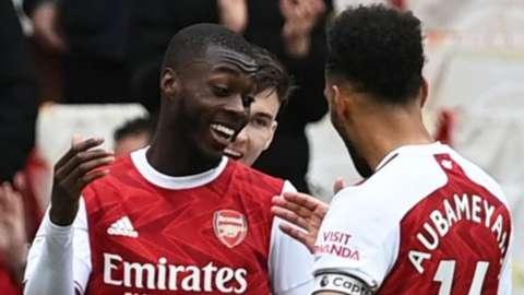 Nicolas Pepe celebrates scoring his second goal against Brighton