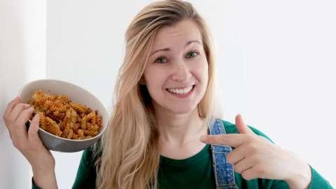 Lady holding bowl of pasta