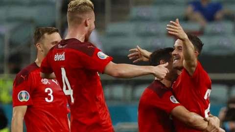Xherdan Shaqiri (right) celebrates his goal with Switzerland team-mates