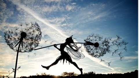 Fairy weightlifter sculpture