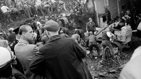 The Duke meets rescue workers and miners in Aberfan as people search through the rubble