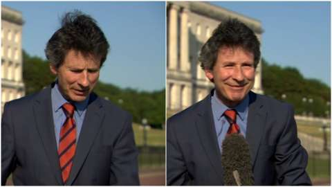 Mark Devenport as his microphone blows away on live TV