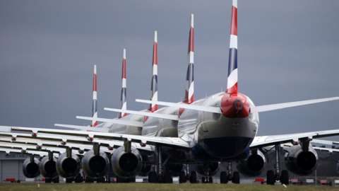 oronavirus outbreak 2020: British Airways passenger planes are seen parked up on a runway at Glasgow Airport on March 25th 2020