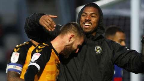 Brandon Cooper (6) of Newport celebrates his match-winning goal with Tristan Abrahams