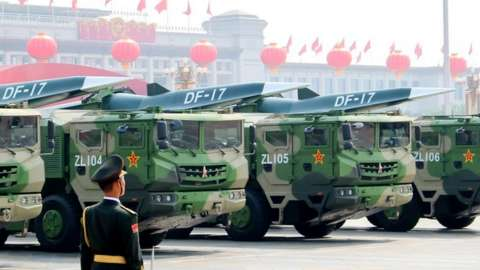 Image shows DF-17 medium-range ballistic missiles equipped with a DF-ZF hypersonic glide vehicle, involved in a military parade to mark the 70th anniversary of the Chinese People's Republic