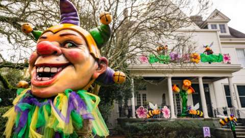 Home decorated to celebrate Mardi Gras with oversized Mardi Gras jesters on 24 January 2021 in New Orleans, Louisiana