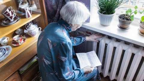 Woman at radiator