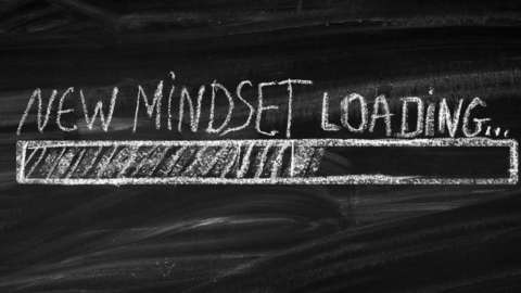Blackboard with New Mindset Loading written across it
