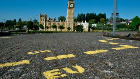 Ground markings are seen at the mock border of the United Kingdom and the European Union during the reopening of the 'Mini-Europe'
