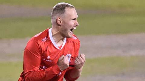 Matthew Parkinson celebrates a wicket for Lancashire