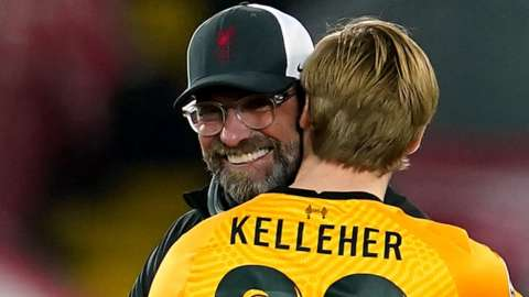 Liverpool boss Jurgen Klopp congratulates keeper Caoimhin Kelleher after a 1-0 win over Ajax in the Champions League