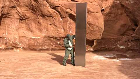 Man stood next to mysterious metal monolith in Utah desert