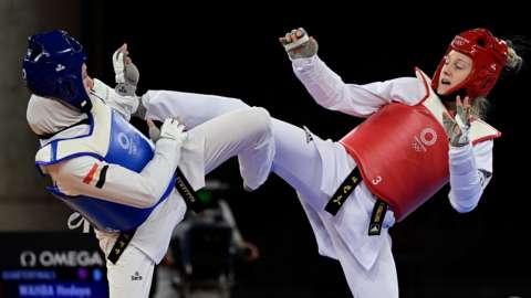 GB's Lauren Williams (right) goes for taekwondo gold