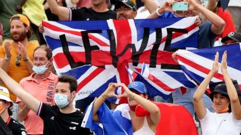 Fans hold up a Lewis Hamilton flag