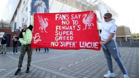 Fans protesting outside Liverpool's stadium