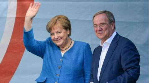 Christian Democratic Union (CDU) party chairman and top candidate for the upcoming federal elections Armin Laschet (R) and German Chancellor Angela Merkel (L) during the election campaign closing of the CDU in Aachen, Germany, 25 September 2021