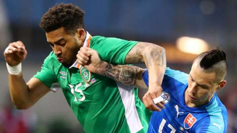 The Republic of Ireland's Cyrus Christie battles with Slovakia's Marek Hamsik in 2016
