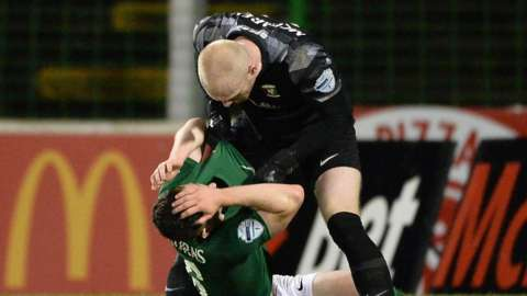 Aaron McCarey clashes with teammate Bobby Burns