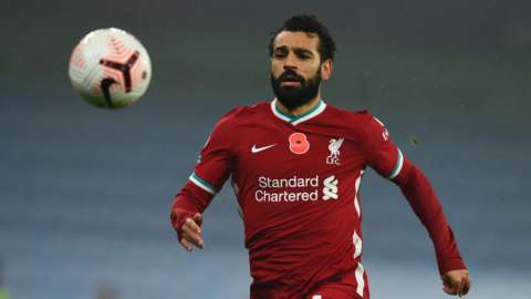 Liverpool forward Mohamed Salah chases down a ball