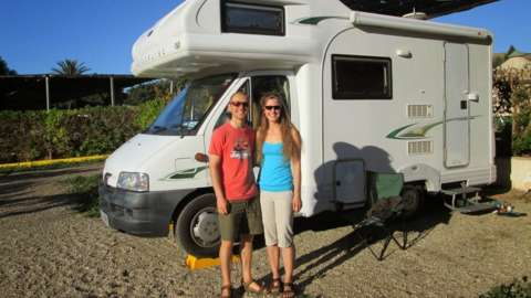 Dan and Esther in front of their campervan