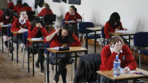 File photo of students sitting an exam